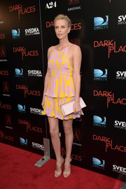 Charlize Theron donned a Christian Dior printed peplum top in vibrant summer colors for the premiere of 'Dark Places.'