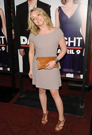 Jane Krakowski's cognac leather clutch was the ideal complement to her taupe dress.
