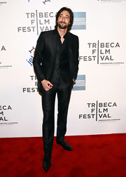 We cannot overlook the always charming Adrien Brody who attended the Chanel Tribeca Film Festival dinner. The dapper gentleman looked chic in a black Dolce & Gabbana three piece suit while his hair was tousled in a carefree style.