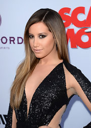 To keep her smoky eyes the center of attention, Ashley Tisdale opted for a nude lip shade.