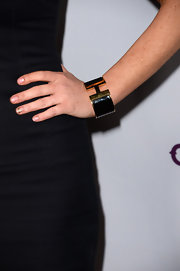 Lindsay Lohan opted for a black and gold cuff bracelet to top off her red carpet look at the premiere of 'Scary Movie 5.'