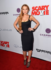 Lindsay Lohan kept her red carpet look simple and chic at the 'Scary Movie 5' premiere where she wore this fitted LBD with delicate gold detailing around the neckline.
