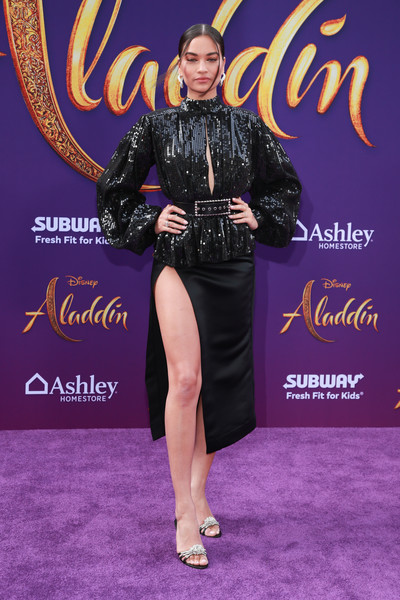 Shanina Shaik shimmered in a black sequined keyhole blouse by Galia Lahav at the premiere of 'Aladdin.'