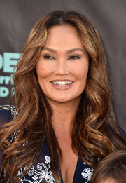 Tia Carrere sported boho center-parted waves at the premiere of 'Alexander and the Terrible, Horrible, No Good, Very Bad Day.'