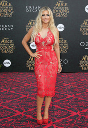 Carmen Electra looked as hot as ever in a curve-hugging red lace dress by Diana Couture at the premiere of 'Alice Through the Looking Glass.'
