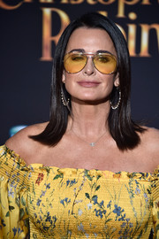 Kyle Richards wore her hair in a sleek shoulder-length style with flipped ends at the premiere of 'Christopher Robin.'