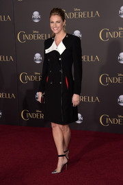 Erin Andrews paired her coat with stylish silver and black PVC cap-toe pumps.