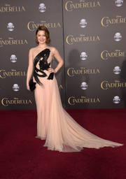 Holliday Grainger made a sweeping entrance in a custom nude Burberry gown, boasting a long train and painterly black embroidery on the bodice, at the Hollywood premiere of 'Cinderella.'