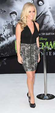 Kendra Wilkinson paired black patent peep-toes with her look-at-me printed peplum.