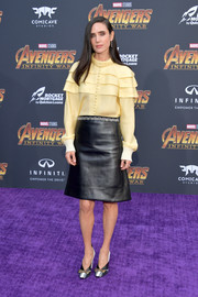 Jennifer Connelly paired her top with a black A-line leather skirt, also by Louis Vuitton.