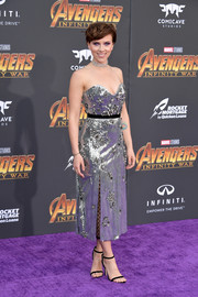 Scarlett Johansson polished off her fabulous look with black slim-strap sandals by Jimmy Choo.
