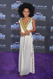 Yara Shahidi was tribal-glam in a white Etro maxi dress with an embroidered neckline and tassel detail at the world premiere of 'Black Panther.'