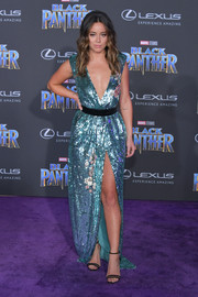 Chloe Bennet finished off her look with a pair of strappy black sandals by Neil J. Rodgers.