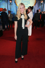 Beth Behrs matched her top with black wide-leg pants.