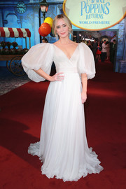 Emily Blunt looked like a fairytale princess in a flowing white Yanina Couture gown with mega-puffed sleeves at the premiere of 'Mary Poppins Returns.'