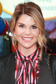 Lori Loughlin styled her hair into a loose ponytail for the premiere of 'Mary Poppins Returns.'