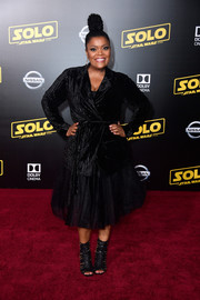 A pair of embellished peep-toe boots rounded out Yvette Nicole Brown's attire.