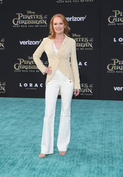 Marg Helgenberger finished off her outfit with a pair of white flare pants.