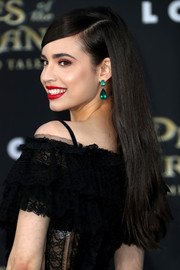 Sofia Carson wore her long hair loose with a deep side part and slicked-down bangs at the premiere of 'Pirates of the Caribbean: Dead Men Tell No Tales.'