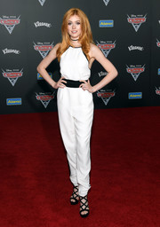 Katherine McNamara was breezy-chic in a backless white jumpsuit with a contrast belt at the premiere of 'Cars 3.'