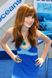 Bella matched her aqua ring to the blues of her dress at the 'Oceans' premiere.