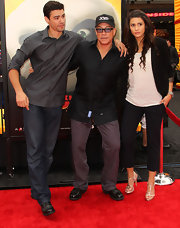 Jean-Claude Van Damme paired gray slacks with a black button-down at the 'Kung Fu Panda 2' premiere.