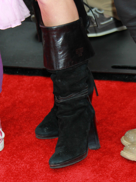 Marcia Gay Harden passed on glam shoes as she wore a pair of suede mid-calf boots at the premiere of 'Kung Fu Panda 2.'