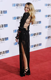 Teresa Palmer paired her knockout gown with knotted black suede platforms.