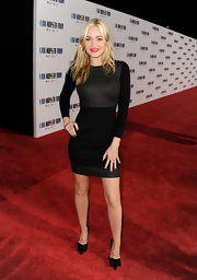Amanda Michalka gave her sultry lbd a girly finish with pointy black satin pumps adorned with bows.
