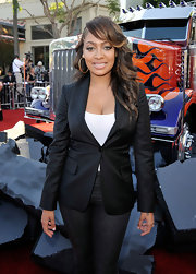 La La Anthony toned down her sexy white top with a black blazer when she attended the premiere of 'Trasformers: Revenge of the Fallen.'
