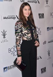 Jessica Biel accessorized with a simple black hard-case clutch by Tyler Ellis at the premiere of 'The Book of Love.'