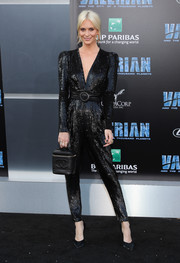 Poppy Delevingne paired her look with a boxy leather purse by Chanel.