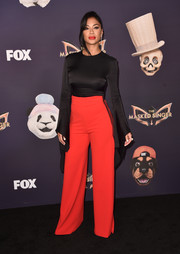 Nicole Scherzinger attended the premiere of 'The Masked Singer' wearing a fitted bell-sleeve top by Solace London.