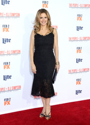 Kelly Preston finished off her red carpet attire with a pair of strappy sandals.