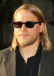 Black wayfarer style shades finish Charlie's cool, unbuttoned look.