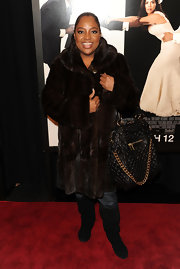 "Funny lady Sherri Shepard came out in her on-trend fur coat carrying a huge quilted ""Alyona"" handbag"". The bag is super cute, but probably not the best choice for a red carpet event."