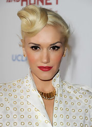 Gwen Stefani wore her hair in a retro-inspired loose bun in a unique placement at the premiere of 'In the Land of Blood and Honey.'