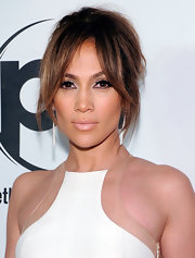 Jennifer pulled her brunette locks up into a messy updo, leaving face-framing fringe in the front.