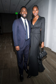 Damaris Lewis attended the 'BlacKkKlansman' after-party carrying a stylish black leather purse.