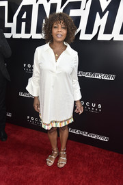 Alfre Woodard attended the premiere of 'BlacKkKlansman' wearing a white tunic dress with a colorful fringed hem.