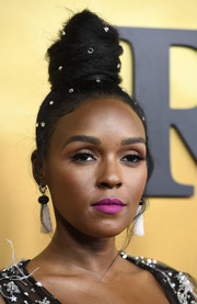 Janelle Monae styled her hair into a towering top knot for the premiere of 'Harriet.'