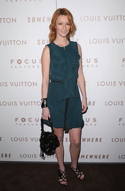 Audrey Marnay paired an emerald green dress with lovely black strappy heels.