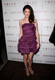 Michelle wore a lovely iridescent purple cocktail dress with sweet ruffles and ruching.