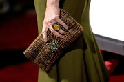 Marcia Gay Harden carried a woven purse with a silver starburst detail at the movie premiere.