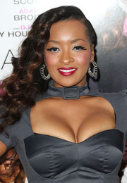 Jennia Fredrique's curly side sweep at the 'Baggage Claim' premiere gave her a retro-glam vibe.