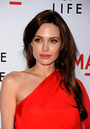Angelina Jolie wore a peachy pink lipstick that was beginning to border on red at 'The Tree of Life' premiere. Instead of matching her lip look to her dress, she took a more subtle approach and softened up the color.