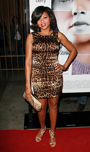 Taraji toned down a tight leopard dress with a sophisticated champagne colored satin clutch.