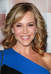 Julie Benz paired her layered curls with elegant diamond stud earrings.
