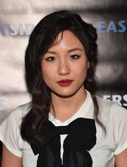 Constance Wu kept her beauty look simple with just a swipe of red lipstick and black eyeliner.