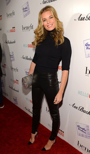 Rebecca Romijn made a simple black turtleneck look oh-so-sexy when she attended the 'Ass Backwards' premiere.